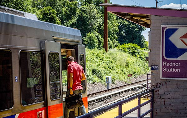 Man getting into train at Radnor Station.